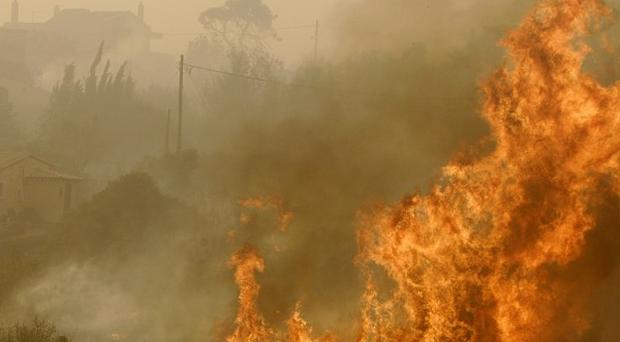 Greek firefighters were battling at least seven large wildfires (AP)