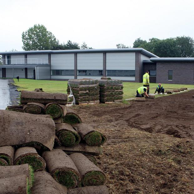 Ground staff put the finishing touches to the new repatriation centre at RAF Brize Norton in Oxfordshire