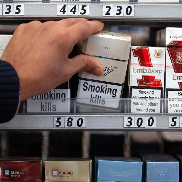 A ban on displaying cigarettes in shops will not begin until next spring at the earliest, the health minister has said