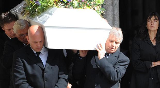 Horatio Chapple's coffin is carried from Salisbury Cathedral in Wiltshire