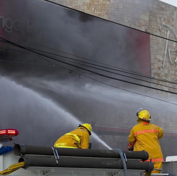 Firefighters at the Casino Royale in Monterrey, Mexico (AP)