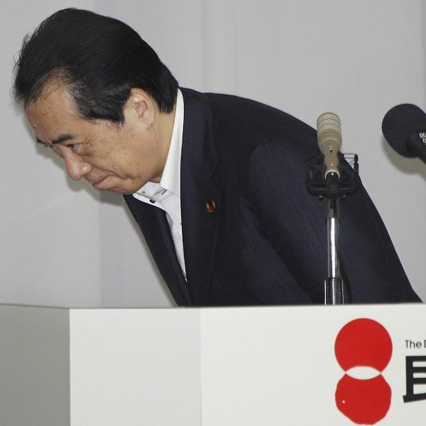 Naoto Kan bows after addressing the Democratic Party of Japan lawmakers' meeting in Tokyo (AP)