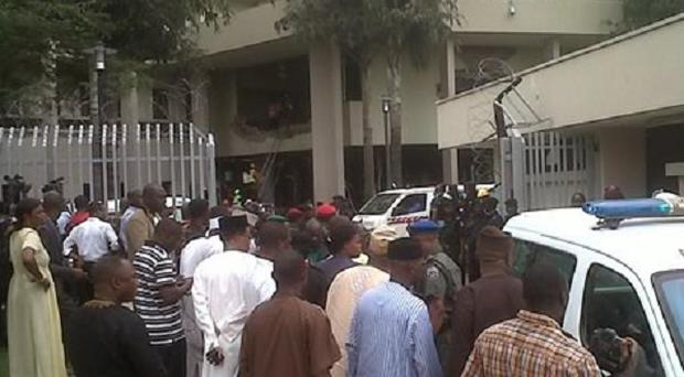 Rescue workers gather at the UN office in Abuja following an attack by a suicide bomber (AP Photo/Saharareporters)