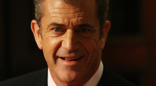 Mel Gibson and his ex-girlfriend have reached a settlement