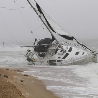 A stranded boat in the Willoughby Spit area of Norfolk, Virginia as Hurricane Irene hits (AP)