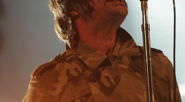 Liam Gallagher performs with Beady Eye at the Reading Festival