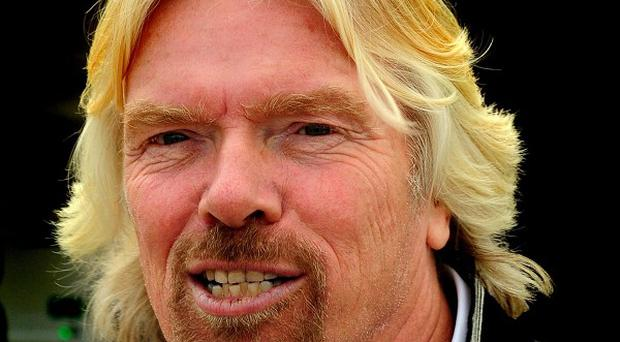 Sir Richard Branson has pulled out of a charity swim after his house burnt down