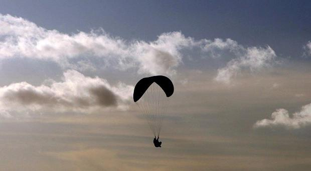A man has died after an accident while paragliding at a Welsh beach