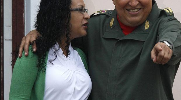 Venezuela's President Hugo Chavez appears with his daughter Rosa at the Miraflores presidential palace in Caracas (AP)