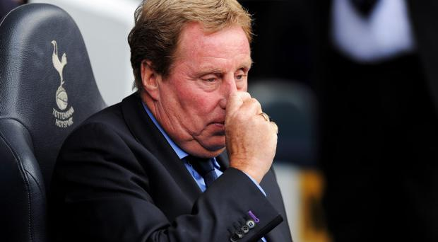 LONDON, ENGLAND - AUGUST 28: Harry Redknapp manager of Tottenham looks on ahead of the Barclays Premier League match between Tottenham Hotspur and Manchester City at White Hart Lane on August 28, 2011 in London, England. (Photo by Michael Regan/Getty Images)