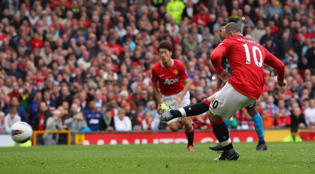 MANCHESTER, ENGLAND - AUGUST 28: Wayne Rooney of Manchester United scores his third goal from the penalty spot during the Barclays Premier League match between Manchester United and Arsenal at Old Trafford on August 28, 2011 in Manchester, England. (Photo by Alex Livesey/Getty Images)