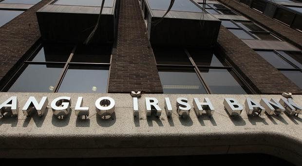 Anglo Irish Bank has significantly reduced its losses since last year