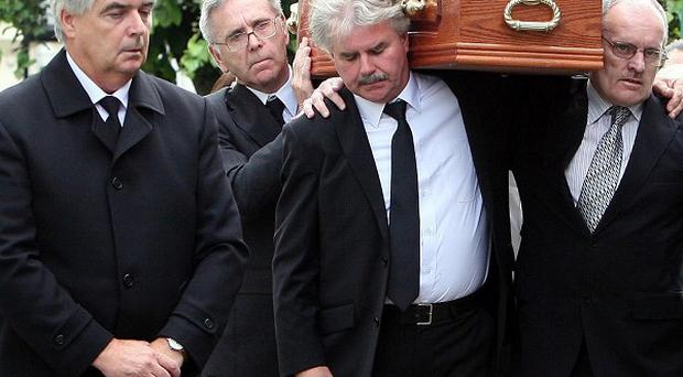 The coffin of Cathy Dinsmore is brought into St Peter's Church in her home town of Warrenpoint for her funeral