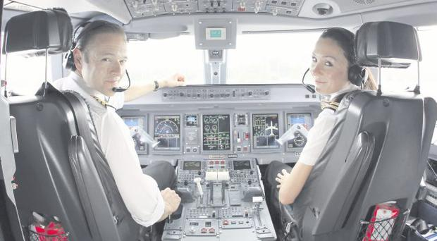 Captain Andy Mackenzie and his wife, first officer Jo Mackenzie, at the controls of a Flybe jet about to depart from Belfast