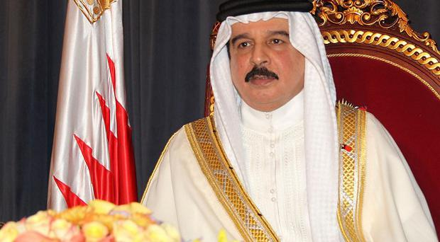Bahrain's King Hamad bin Isa Al Khalifa said the state will dismiss charges against some people detained during crackdowns against Shiite-led protests (AP)