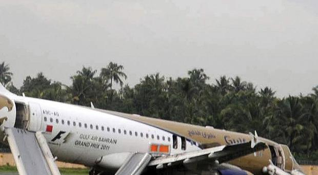 A Gulf Air plane lies on the ground after it skidded off the runway at Kochi International Airport (AP)