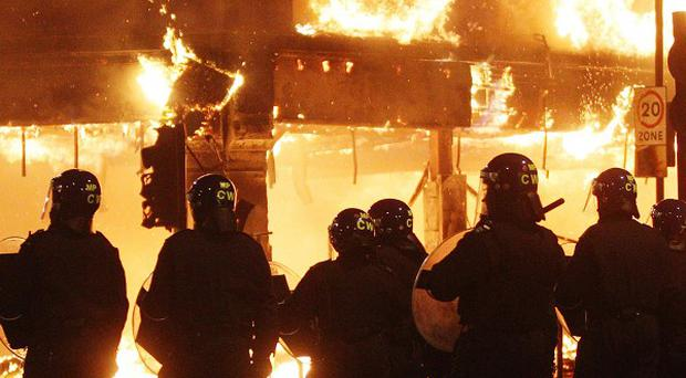 A man has been charged with attempted grievous bodily harm with intent on two police officers during recent rioting in London