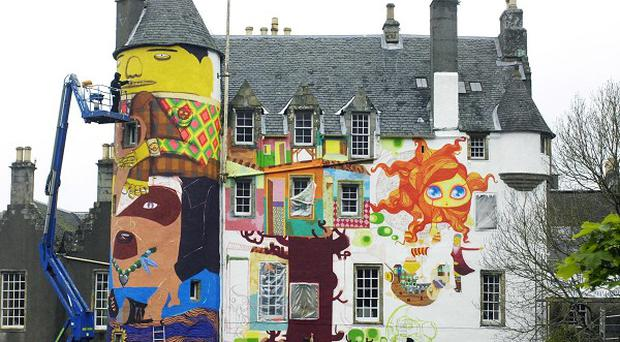 A peer has asked to keep a controversial graffiti mural on the walls of his family's 13th century castle