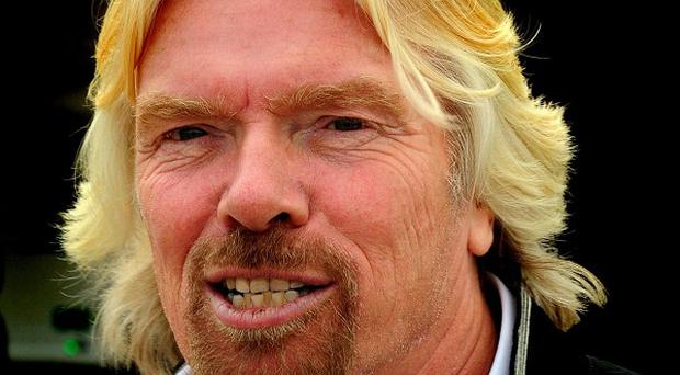 Sir Richard Branson has had to pull out of a charity swin across the Irish Sea