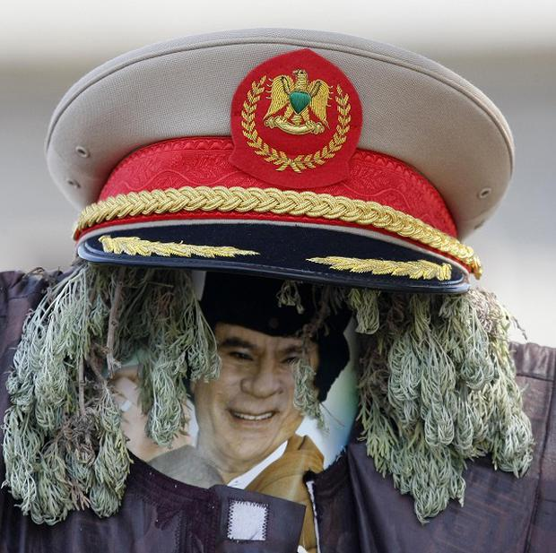 An effigy of Gaddafi is seen at a checkpoint in Tripoli (AP)