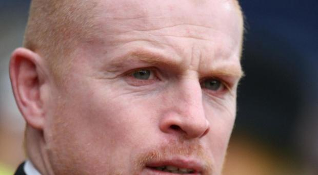 John Wilson is accused of attacking Celtic manager Neil Lennon at a football match