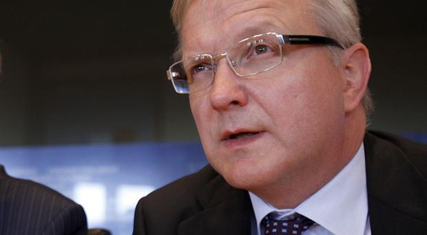 European Commissioner Olli Rehn, right, with Eurogroup chief Jean-Claude Juncker, warns of more financial turmoil (AP)