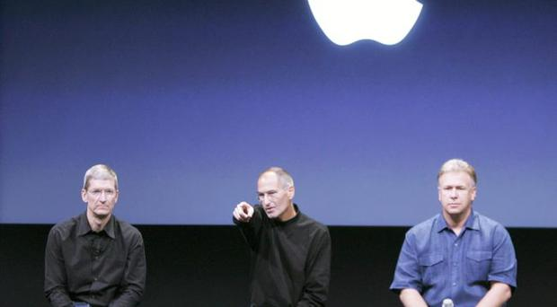 Tim Cook (left) has taken over from Steve Jobs (centre) at Apple