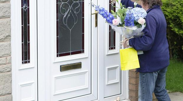 Flowers are delivered to the family home of Ian Redmond, in Nelson, Lancashire, who was killed by a shark in the Seychelles on his honeymoon