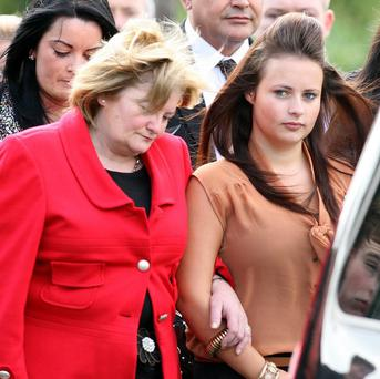Shannon Graham (right) is supported by family members at the funeral of her mother Marian