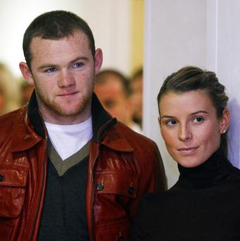 Coleen Rooney, pictured with husband Wayne, lost her mobile phone at the MEN Arena