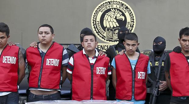 Five alleged members of the Zetas drug cartel, who are suspected over the fatal arson fire at a casino in Monterrey last Thursday (AP)