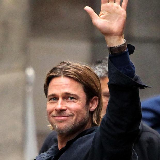 Brad Pitt waves as he leaves the set of World War Z near George Square, Glasgow