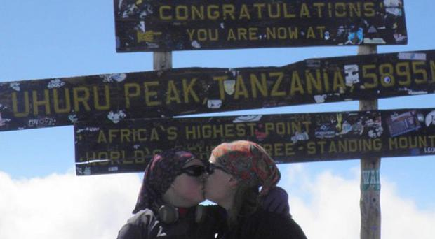 Sarah O'Neill with her mother Sinead (right) after the 11-year-old from Co Tipperary has become the youngest girl ever to scale Mount Kilimanjaro