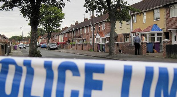 Police cordon off Brayfield Road, Liverpool, after a man was gunned down in the street