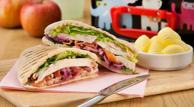Pitta roll-ups with chicken and coleslaw