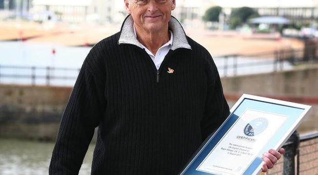 Roger Allsopp holds a certificate marking his achievement