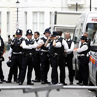 Police at the Notting Hill Carnival where a man was assaulted