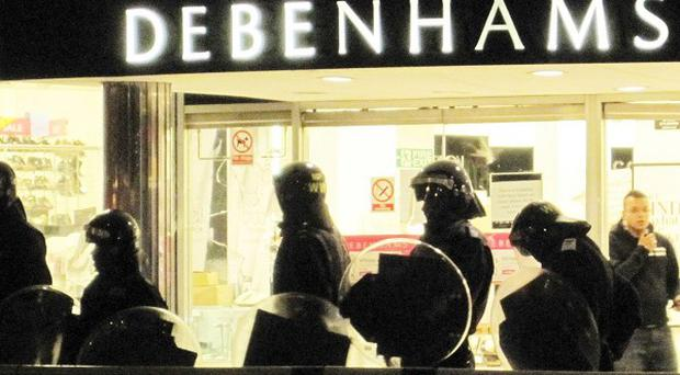 A boy, 11, took a bin from Debenhams during the riots on August 8
