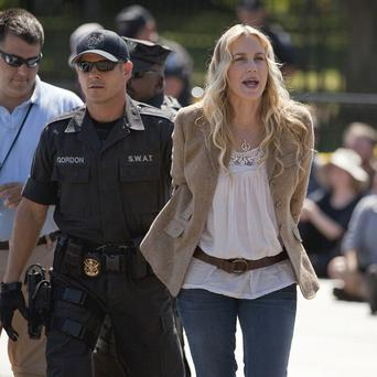 Actress Daryl Hannah is arrested byUS Park Police in front of the White House in Washington during a protest over an oil pipeline(AP)