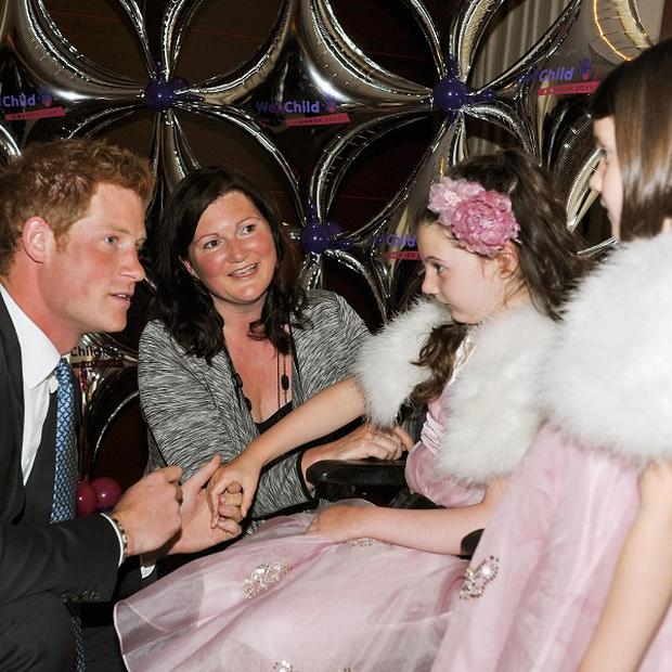 Prince Harry talks with the Moore family at the national Wellchild awards