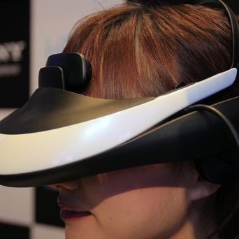 Sony's news personal 3-D viewer displayed by a model(AP)