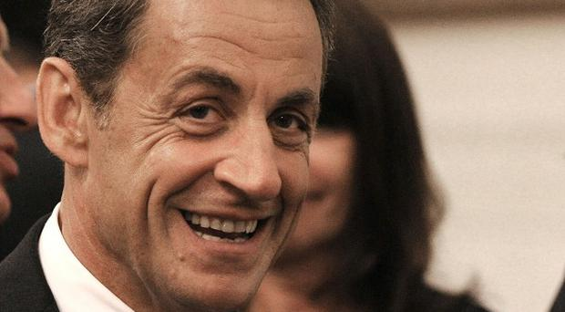 French President Nicolas Sarkozy has denied new claims that he received secret campaign funds(AP)