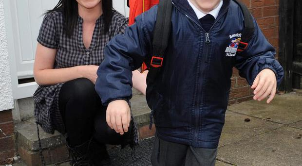 Cameron Mann (5) pictured on his first day of school with his mum Claire