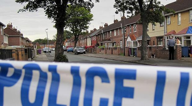 Detectives are examining two cars as part of their investigation into a shooting in Liverpool