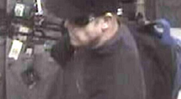 A CCTV still issued by Kent Police shows a man they would like help finding in connection with two bomb hoaxes