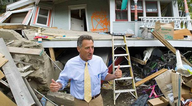 Vermont Governor Peter Shumlin surveys the damage to a house (AP)