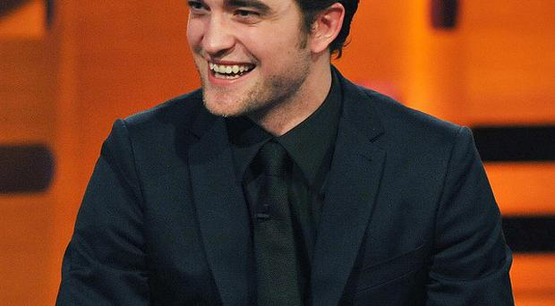 Robert Pattinson is said to have bought a tramp a guitar