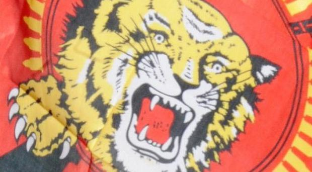 The defeated rebel Tamil Tiger group remains outlawed in Sri Lanka despite the lifting of wartime emergency laws