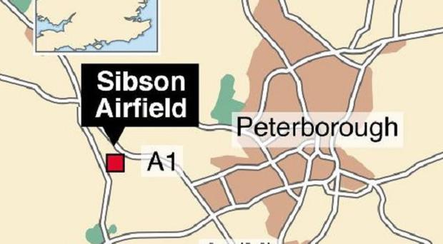 The scene of the crash near Sibson Airfield, close to Peterborough, has been cordoned off