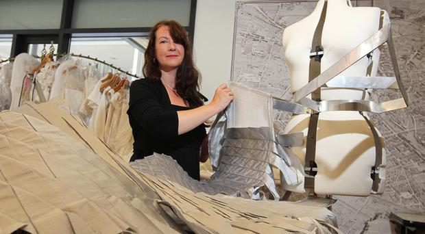 Designer Lizzie Agnew working on the Titanic Dress, a maritime-themed gown to be created with the help of a welder for Titanic centenary celebrations